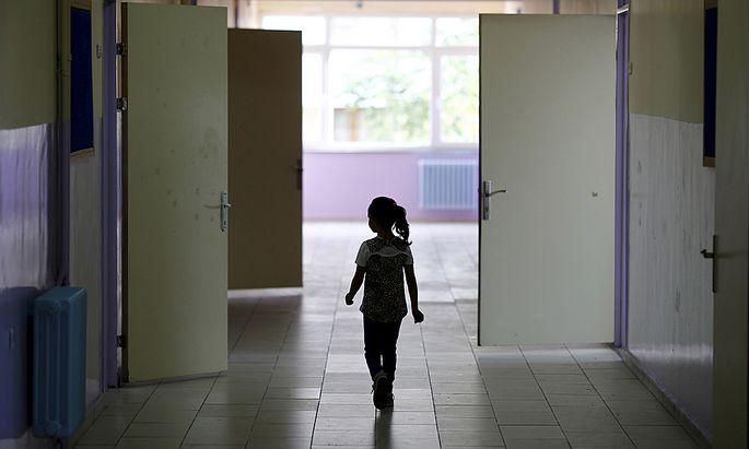 A Syrian refugee student walks along a corridor at Fatih Sultan Mehmet School in Karapurcek district of Ankara