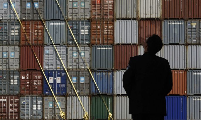 Security guard stands in front of the Yantian International Container Terminal in the southern Chinese city of Shenzhen