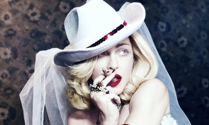 """Den Cowgirl-Hut von """"Music"""" (2000) hat sie noch: Motiv aus Madonnas neuem PR-Material."""