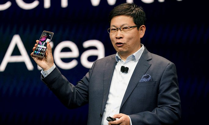 Richard Yu, CEO of the Huawei Consumer Business Group, holding a Huawei Mte 10 Pro cellphone, speaks at the Huawei keynote at CES in Las Vegas