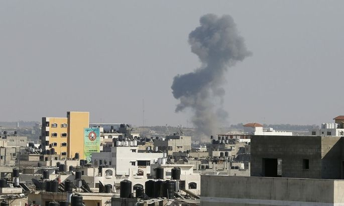 Smoke is seen after what witnesses said was an Israeli air strike in Gaza City