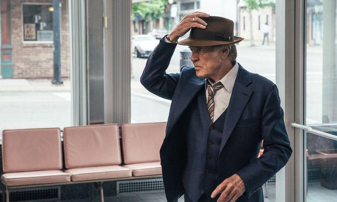Immer sympathisch, hier mit Hut als Markenzeichen: Der 82-jährige Robert Redford als Bankräuber.