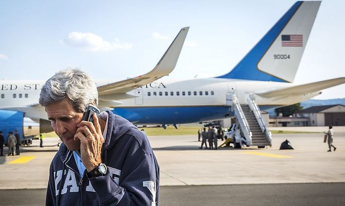 U.S. Secretary of State John Kerry speaks on his phone while his plane refuels at Ramstein Air Base in Ramstein-Miesenbach