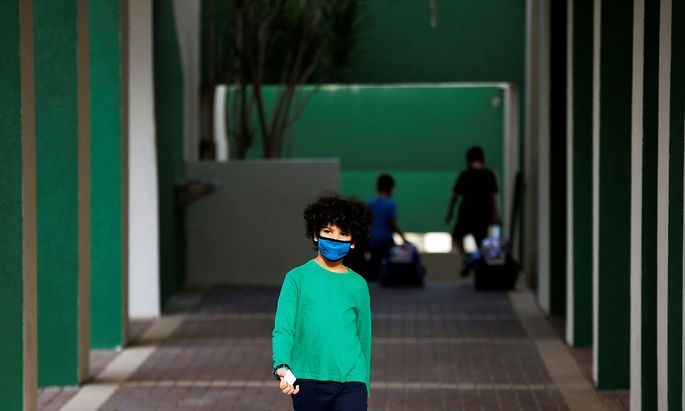 A pupil wearing a protective face mask, looks on as Israel reopens first to fourth grades, continuing to ease a second nationwide coronavirus disease (COVID-19) lockdown, at a school in Rehovot