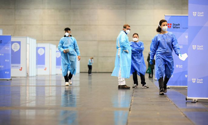 Medical workers wait at a COVID-19 vaccination station during a mass vaccination programme forhealth care workers against the coronavirus disease in Vienna