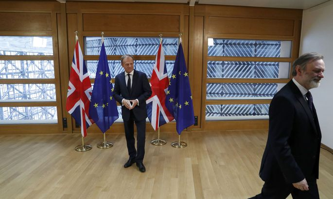 Britain´s permanent representative to the European Union Tim Barrow leaves after he delivered British Prime Minister Theresa May´s Brexit letter to EU Council President Donald Tusk in Brussels