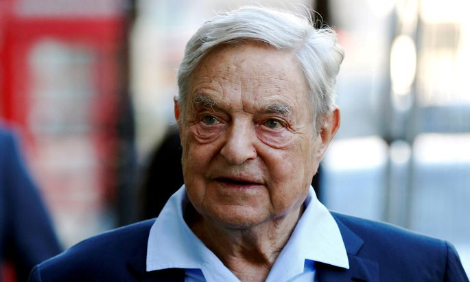 FILE PHOTO: George Soros arrives to speak at the Open Russia Club in London