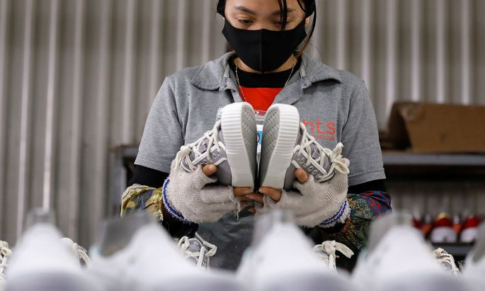 Making of shoes for export at a factory in Hanoi
