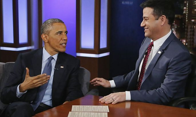 Obama talks with show host Jimmy Kimmel during a commercial break in a taping of Jimmy Kimmel Live in Los Angeles