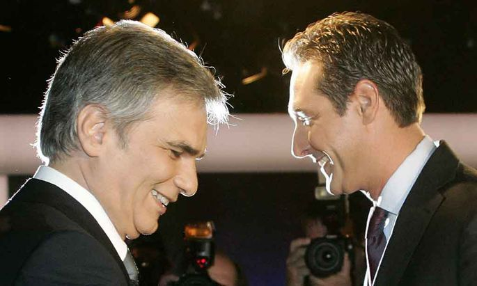 Head of the Socialist Party Faymann and head of the Freedom Party Strache await start of TV discussion in Vienna