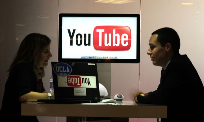 File photo of visitors at ´You Tube´ stand during the MIDEM in Cannes