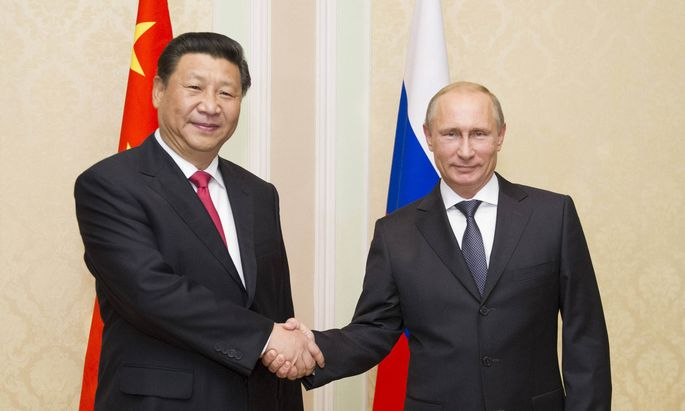 140911 DUSHANBE Sept 11 2014 Chinese President Xi Jinping L meets with his Russian coun