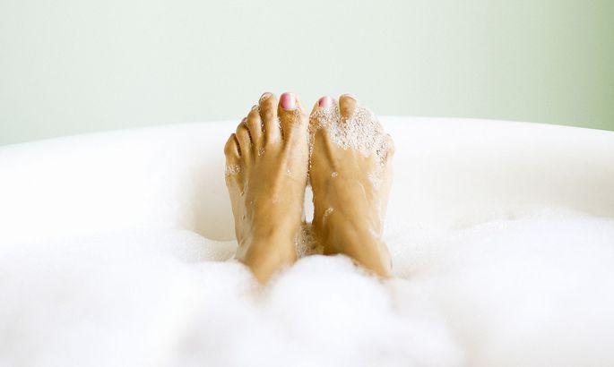 Woman's Feet Emerging in Bubble Bath