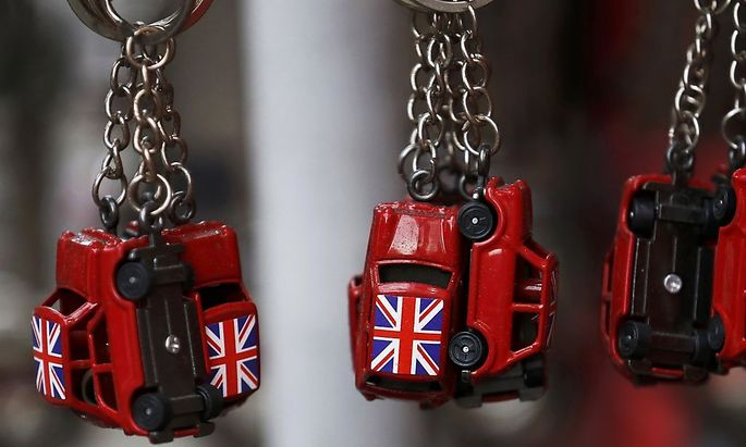 Union flags are painted onto car shaped keyrings for sale in London, Britain