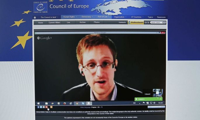 File photo of accused government whistleblower Snowden seen on the computer screen of a journalist as he speaks via video somewhere in Moscow
