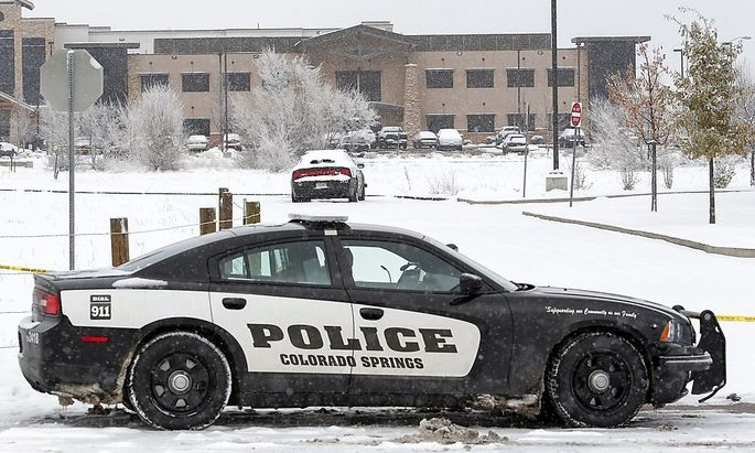 A Colorado Springs Police car blocks the entrance outside the Planned Parenthood clinic a day after a gunman opened fire in Colorado Springs