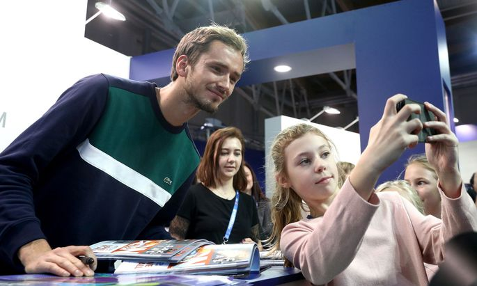 MOSCOW, RUSSIA - OCTOBER 15, 2019: Russian tennis player Daniil Medvedev (L) poses for a selfie after a press conferenc