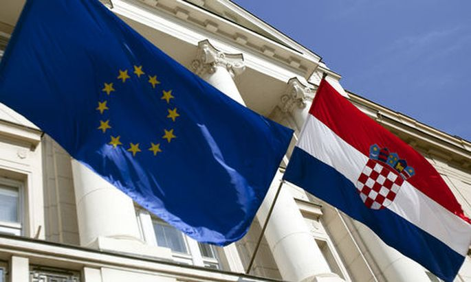 The Croatian and EU flags are seen at the parliament building at St. Mark square in Zagreb, Croatia,