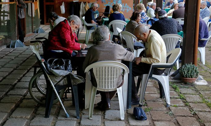 Elderly people play cards in Rome