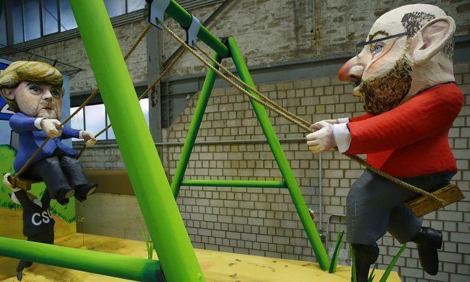 Auf Kollisionskurs: Die Sicht der Karnevalisten auf die GroKo unter Merkel und Schulz.