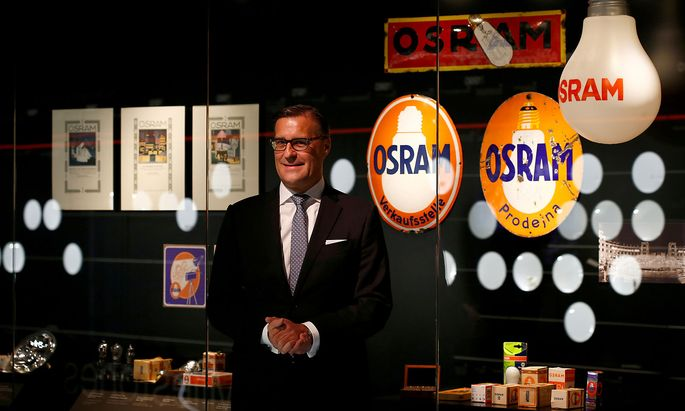 FILE PHOTO: CEO of lamp manufacturer Osram Olaf Berlien poses during opening of company 'World of light' showroom in Munich