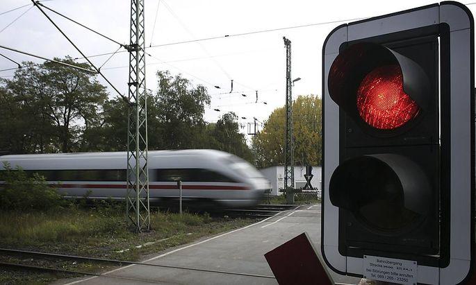 File photo of ICE high speed train of Deutsche Bahn speeding past red light outside the main train station of Hanau
