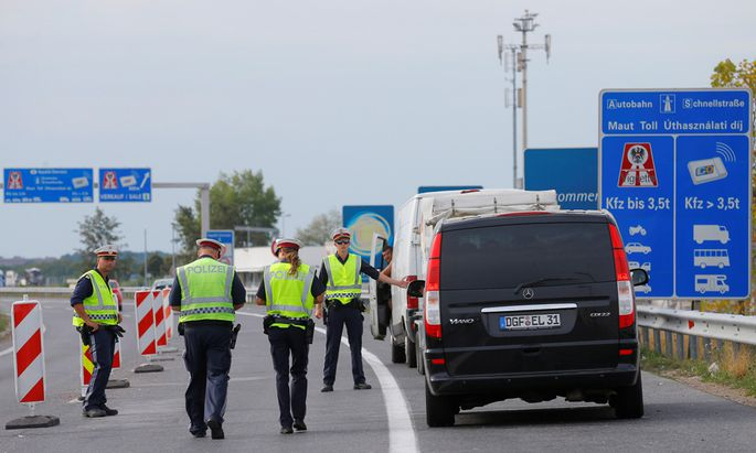 Police perform border control at the Austrian-Hungarian border in Nickelsdorf