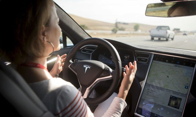 New Autopilot features are demonstrated in a Tesla Model S during a Tesla event in Palo Alto, California