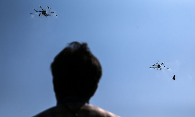 Drone flies and sprays chemicals during an operation to reduce air pollution in Bangkok