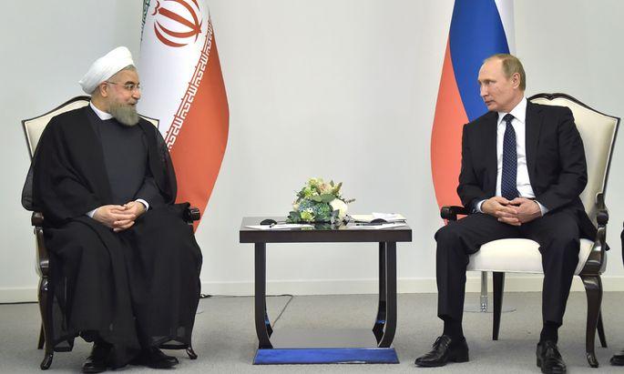 Hassan Rohani (l.) und Wladimir Putin