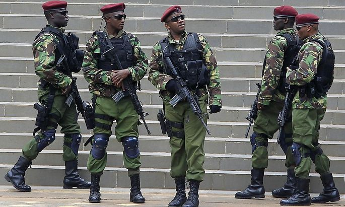 Kenyan para-military units take their positions during the Africa Union Peace and Security Council Summit on Terrorism at the Kenyatta International Convention Centre in Nairobi
