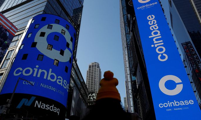 FILE PHOTO: The logo for Coinbase Global Inc is displayed on the Nasdaq MarketSite jumbotron and others at Times Square in New York
