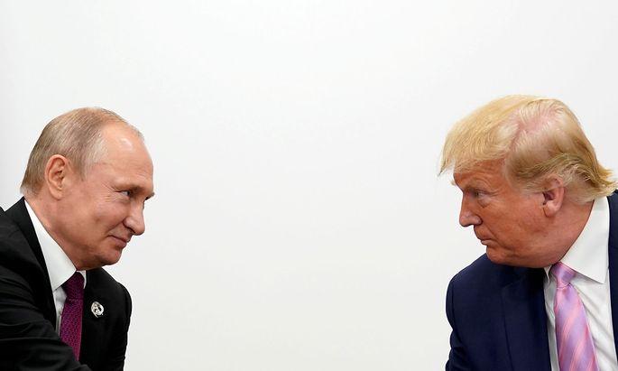 Archivbild: Putin und Trump bei einem Treffen im vergangenen Juni.