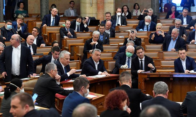 Hungarian Prime Minister Viktor Orban votes the law granting the government special powers to combat the coronavirus disease (COVID-19) crisis at the Hungarian parliament in Budapest