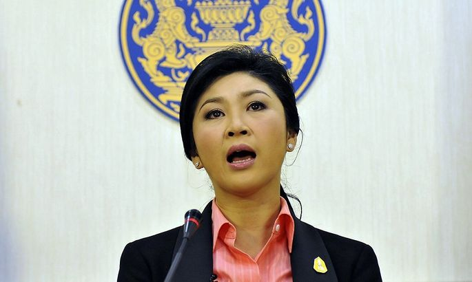 Thai Prime Minister Yingluck Shinawatra talks during a news conference at police headquarters in Bangkok