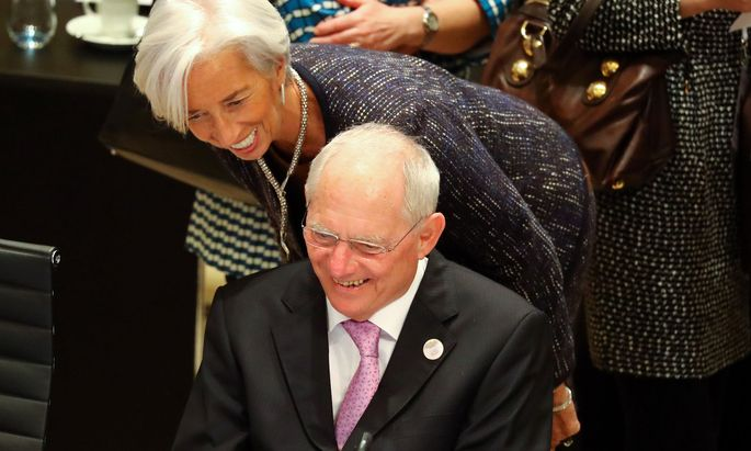 FILE PHOTO: German Finance Minister Wolfgang Schaeuble talks to IMF Managing Director Christine Lagarde during the G20 Finance Ministers and Central Bank Governors Meeting in Baden-Baden