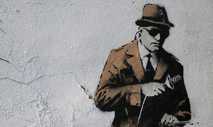A detail from graffiti art is seen on a wall near the headquarters of Britain´s eavesdropping agency, GCHQ, in Cheltenham, western England