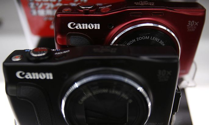 Canon´s logos are seen on compact digital camera on display at an electronics retail store in Tokyo