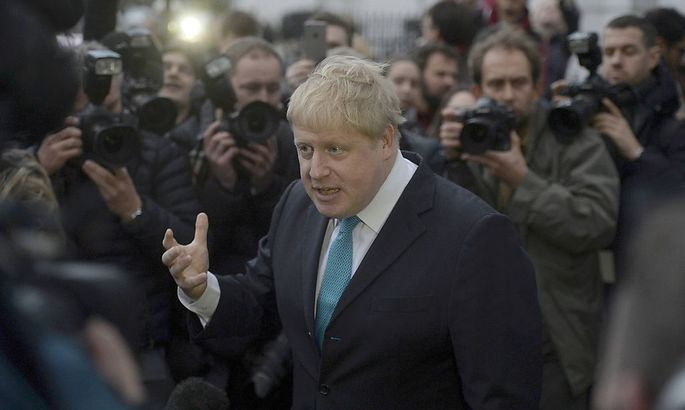London Mayor Boris Johnson speaks to the media in front of his home in London
