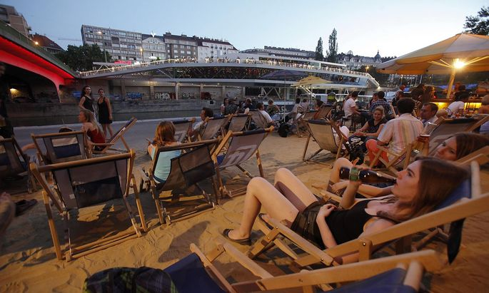 People enjoy the evening at Donaukanal in the centre of Vienna