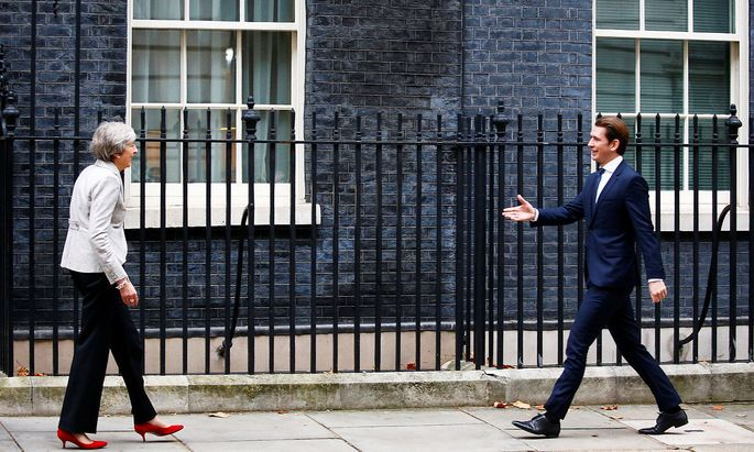 Britain's Prime Minister Theresa May greets Austrian Chancellor Sebastian Kurz in Downing Street in London