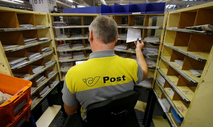 A worker sorts mail at Austrian Post logistics centre in Vienna