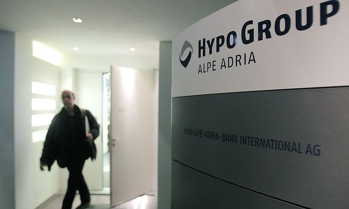 A man leaves the office of nationalised Austrian lender Hypo Alpe Adria in Vienna
