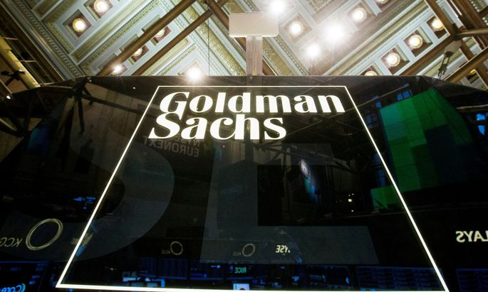 FILE PHOTO: Goldman Sachs sign is seen above floor of the New York Stock Exchange shortly after the opening bell in the Manhattan borough of New York