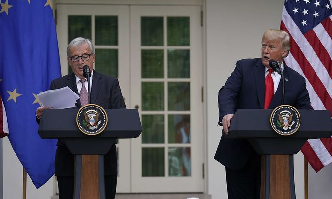 European Commission President Juncker and U.S. President Trump talk to the news media at the White House in Washington