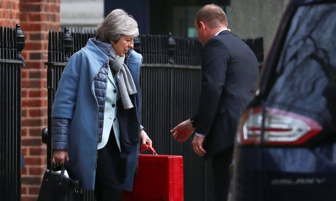 Britain's Prime Minister Theresa May leaves Downing Street, London
