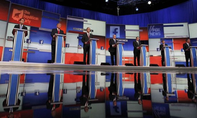 Republican 2016 presidential candidates stand at their podiums at the first official Republican presidential candidates debate of the 2016 U.S. presidential campaign in Cleveland