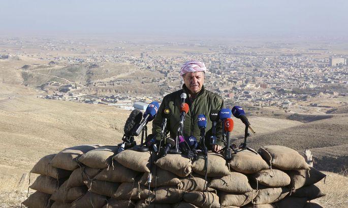 Iraqi Kurdish Regional President Massoud Barzani speaks during a news conference in the town of Sinjar, Iraq