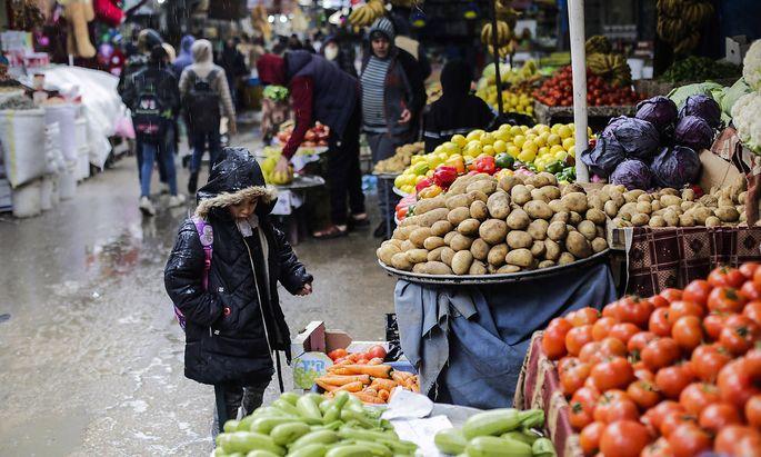 January 22, 2020, Gaza City, The Gaza Strip, Palestine: Palestinians march in the Al-Zawiya market during heavy rains in