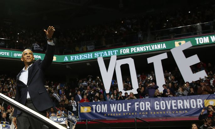 U.S. President Obama waves before he speaks at a campaign event for Wolf, who is running for Governor of Pennsylvania, in the Liacouras Center at Temple University in Philadelphia